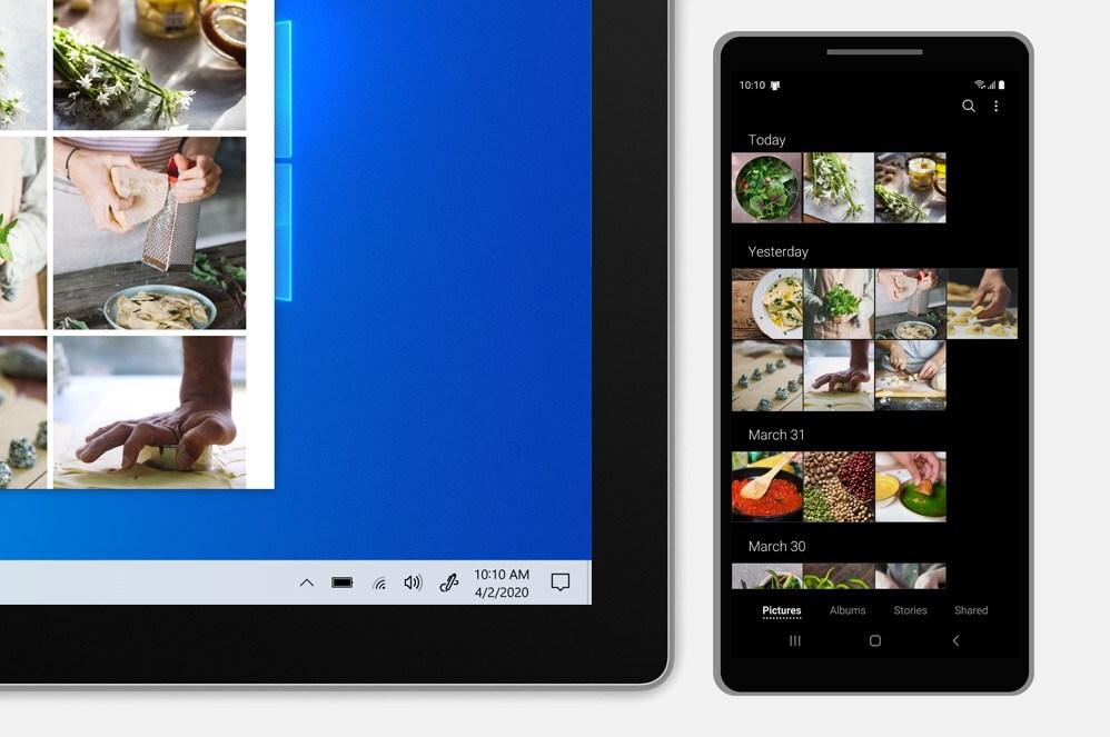 Surface Pro 7 旁边放着一部手机