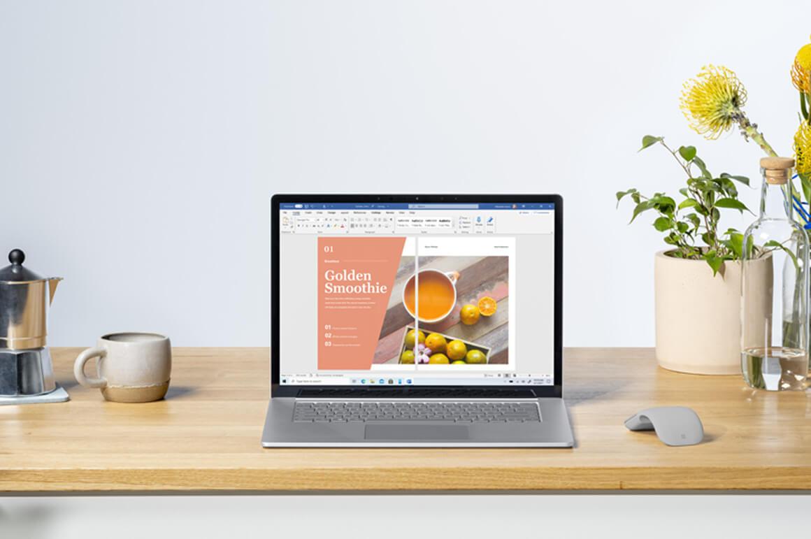 Surface Laptop 4 置于办公桌上,周围有小键盘、鼠标、台灯等其他物品
