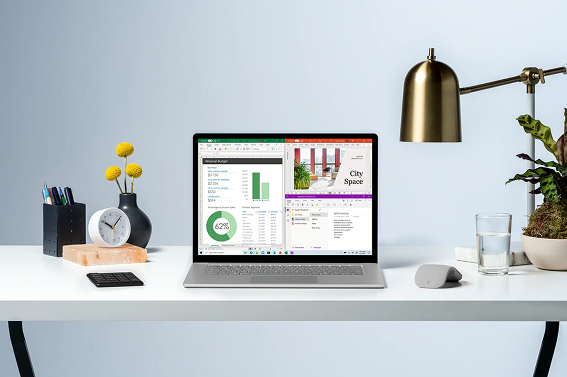 Surface Laptop 4 置于桌上,周围有绿植和咖啡杯