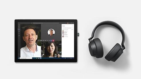 Surface Headphones 2+ 商用版置于 Surface 设备旁